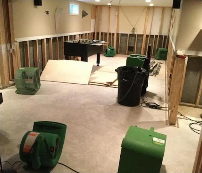 cut open walls and equipment drying the area