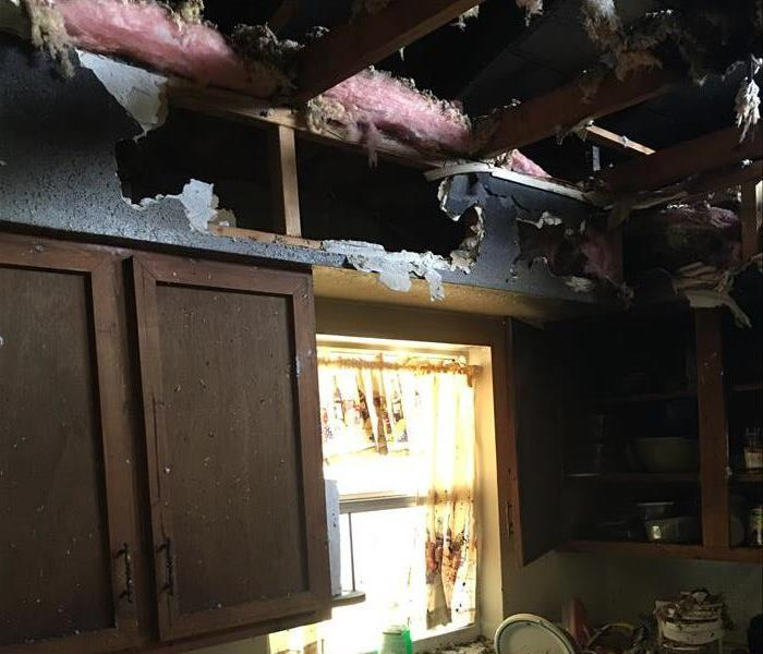 visibly burned ceiling and debris on sink counter area