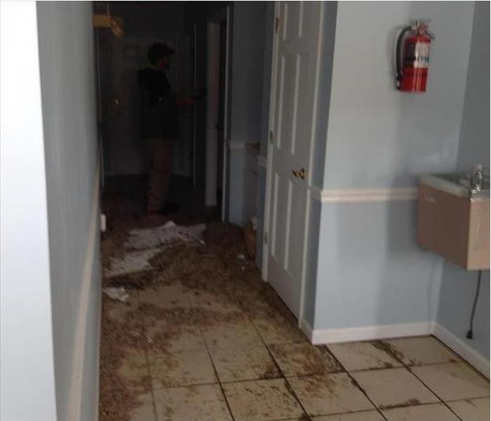 sewage and debris on tiled floor