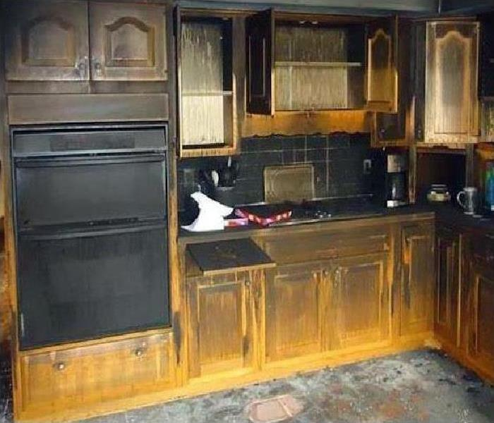 kitchen damaged by fire and smoke
