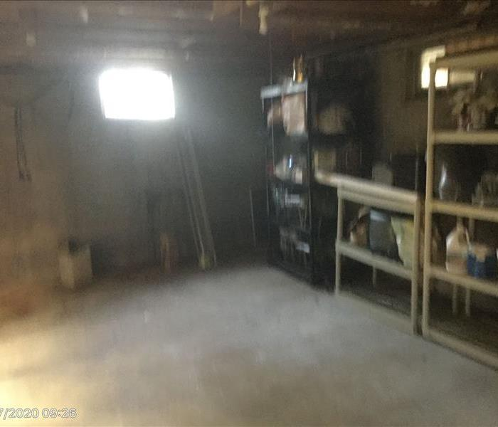 Basement with shelves that have items