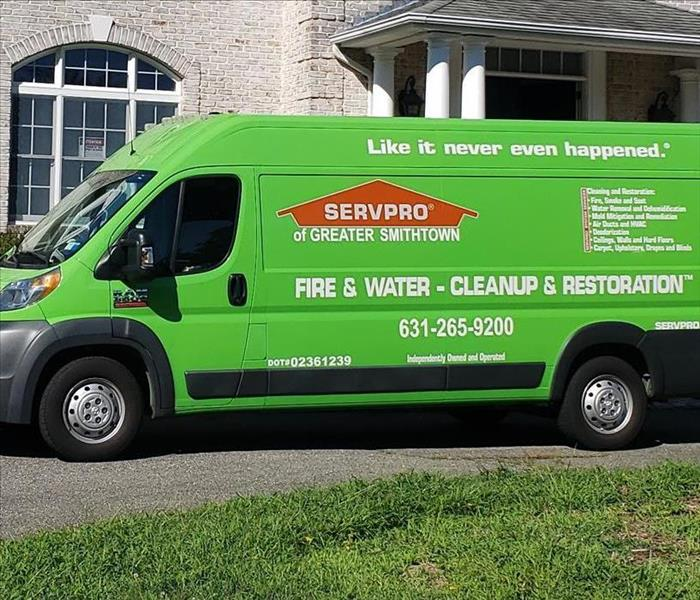 SERVPRO green van parked at building