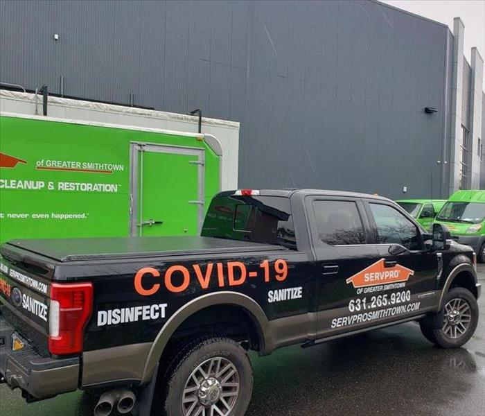 A SERVPRO truck in front of a building.